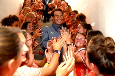 PARIS, FRANCE - JUNE 09: Rafael Nadal of Spain leaves the court as he is congratulated on victory from the ball boys and girls following the mens singles final against Dominic Thiem of Austria during Day fifteen of the 2019 French Open at Roland Garros on June 09, 2019 in Paris, France. (Photo by Clive Brunskill/Getty Images)