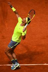 PARIS, FRANCE - JUNE 09: Rafael Nadal of Spain serves during the mens singles final against Dominic Thiem of Austria during Day fifteen of the 2019 French Open at Roland Garros on June 09, 2019 in Paris, France. (Photo by Clive Mason/Getty Images)