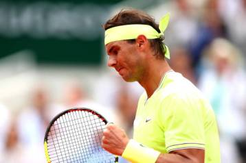 PARIS, FRANCE - JUNE 09: Rafael Nadal of Spain celebrates during the mens singles final against Dominic Thiem of Austria during Day fifteen of the 2019 French Open at Roland Garros on June 09, 2019 in Paris, France. (Photo by Clive Brunskill/Getty Images)