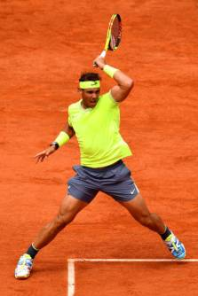 PARIS, FRANCE - JUNE 09: Rafael Nadal of Spain plays a forehand during the mens singles final against Dominic Thiem of Austria during Day fifteen of the 2019 French Open at Roland Garros on June 09, 2019 in Paris, France. (Photo by Clive Mason/Getty Images)