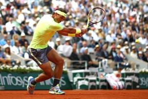 PARIS, FRANCE - JUNE 09: Rafael Nadal of Spain plays a backhand during the mens singles final against Dominic Thiem of Austria during Day fifteen of the 2019 French Open at Roland Garros on June 09, 2019 in Paris, France. (Photo by Julian Finney/Getty Images)