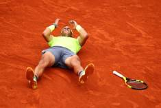 PARIS, FRANCE - JUNE 09: Rafael Nadal of Spain celebrates match point following the mens singles final against Dominic Thiem of Austria during Day fifteen of the 2019 French Open at Roland Garros on June 09, 2019 in Paris, France. (Photo by Clive Brunskill/Getty Images)