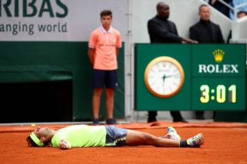 PARIS, FRANCE - JUNE 09: Rafael Nadal of Spain celebrates match point following the mens singles final against Dominic Thiem of Austria during Day fifteen of the 2019 French Open at Roland Garros on June 09, 2019 in Paris, France. (Photo by Julian Finney/Getty Images)