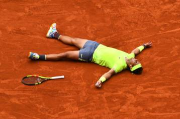 PARIS, FRANCE - JUNE 09: Rafael Nadal of Spain celebrates match point following the mens singles final against Dominic Thiem of Austria during Day fifteen of the 2019 French Open at Roland Garros on June 09, 2019 in Paris, France. (Photo by Clive Mason/Getty Images)