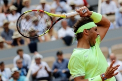 Spain's Rafael Nadal serves the ball to Japan's Kei Nishikori during their men's singles quarter-final match on day ten of The Roland Garros 2019 French Open tennis tournament in Paris on June 4, 2019. (Photo by Thomas SAMSON / AFP) (Photo credit should read THOMAS SAMSON/AFP/Getty Images)