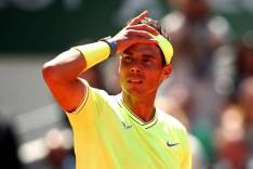 PARIS, FRANCE - JUNE 07: Rafael Nadal of Spain takes off her sweatband during his mens singles semi-final match against Roger Federer of Switzerland during Day thirteen of the 2019 French Open at Roland Garros on June 07, 2019 in Paris, France. (Photo by Clive Brunskill/Getty Images)
