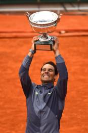 PARIS, FRANCE - JUNE 09: Rafael Nadal of Spain celebrates with the trophy following the mens singles final against Dominic Thiem of Austria during Day fifteen of the 2019 French Open at Roland Garros on June 09, 2019 in Paris, France. (Photo by Clive Mason/Getty Images)