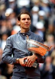 PARIS, FRANCE - JUNE 09: Rafael Nadal of Spain celebrates with the trophy following the mens singles final against Dominic Thiem of Austria during Day fifteen of the 2019 French Open at Roland Garros on June 09, 2019 in Paris, France. (Photo by Julian Finney/Getty Images)
