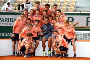 PARIS, FRANCE - JUNE 09: Rafael Nadal of Spain celebrates victory with the ball boys following his mens singles final against Dominic Thiem of Austria during Day fifteen of the 2019 French Open at Roland Garros on June 09, 2019 in Paris, France. (Photo by Julian Finney/Getty Images)