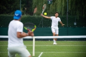 Dominic Thiem (AUT) rallies with Rafael Nadal (ESP) on the Competitors' Practice Courts. The Championships 2019. Held at The All England Lawn Tennis Club, Wimbledon. 20190626. Credit: AELTC/Thomas Lovelock.