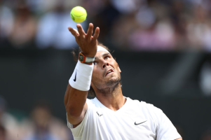 8th July 2019, The All England Lawn Tennis and Croquet Club, Wimbledon, England, Wimbledon Tennis Tournament, Day 7; Rafael Nadal serves against João Sousa (por) (photo by Shaun Brooks/Action Plus via Getty Images)