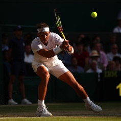 LONDON, ENGLAND - JULY 12: Rafael Nadal of Spain plays a backhand in his Men's Singles semi-final match against Roger Federer of Switzerland during Day eleven of The Championships - Wimbledon 2019 at All England Lawn Tennis and Croquet Club on July 12, 2019 in London, England. (Photo by Clive Brunskill/Getty Images)