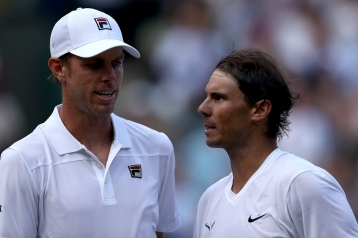 10th July 2019, The All England Lawn Tennis and Croquet Club, Wimbledon, England, Wimbledon Tennis Tournament, Day 9; Rafael Nadal (ESP) speaks with Sam Querrey (USA) (photo by Shaun Brooks/Action Plus via Getty Images)