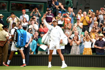 LONDON, ENGLAND - JULY 04: Rafael Nadal of Spain celebrates victory as he walks off the court after his Men's Singles second round match against Nick Kyrgios of Australia during Day four of The Championships - Wimbledon 2019 at All England Lawn Tennis and Croquet Club on July 04, 2019 in London, England. (Photo by Mike Hewitt/Getty Images)