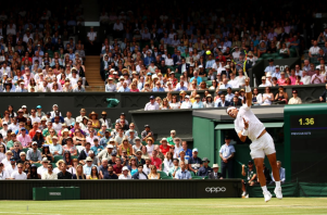 LONDON, ENGLAND - JULY 08: Rafael Nadal of Spain serves in his Men's Singles fourth round match against Joao Sousa of Portugal during Day Seven of The Championships - Wimbledon 2019 at All England Lawn Tennis and Croquet Club on July 08, 2019 in London, England. (Photo by Clive Brunskill/Getty Images)