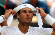 Rafael Nadal changes his head band during his match on day seven of the Wimbledon Championships at the All England Lawn Tennis and Croquet Club, Wimbledon. (Photo by Adam Davy/PA Images via Getty Images)