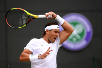 LONDON, ENGLAND - JULY 10: Rafael Nadal of Spain plays a forehand in his Men's Singles Quarter Final match against Sam Querrey of the United States during Day Nine of The Championships - Wimbledon 2019 at All England Lawn Tennis and Croquet Club on July 10, 2019 in London, England. (Photo by Laurence Griffiths/Getty Images)