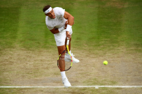 LONDON, ENGLAND - JULY 10: Rafael Nadal of Spain serves in his Men's Singles Quarter Final match against Sam Querrey of the United States during Day Nine of The Championships - Wimbledon 2019 at All England Lawn Tennis and Croquet Club on July 10, 2019 in London, England. (Photo by Clive Brunskill/Getty Images)