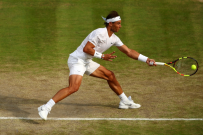 LONDON, ENGLAND - JULY 10: Rafael Nadal of Spain plays a forehand in his Men's Singles Quarter Final match against Sam Querrey of the United States during Day Nine of The Championships - Wimbledon 2019 at All England Lawn Tennis and Croquet Club on July 10, 2019 in London, England. (Photo by Clive Brunskill/Getty Images)