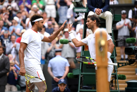 LONDON, ENGLAND - JULY 06: Jo-Wilfred Tsonga of France and Rafael Nadal of Spain shake hands at the net following their Men's Singles third round match during Day six of The Championships - Wimbledon 2019 at All England Lawn Tennis and Croquet Club on July 06, 2019 in London, England. (Photo by Matthias Hangst/Getty Images)