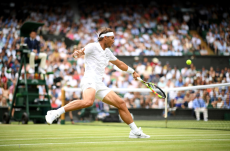 LONDON, ENGLAND - JULY 06: Rafael Nadal of Spain plays a backhand in his Men's Singles third round match against Jo-Wilfred Tsonga of France during Day six of The Championships - Wimbledon 2019 at All England Lawn Tennis and Croquet Club on July 06, 2019 in London, England. (Photo by Matthias Hangst/Getty Images)