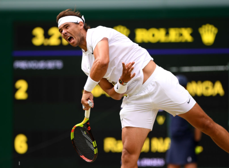 LONDON, ENGLAND - JULY 06: Rafael Nadal of Spain serves in his Men's Singles third round match against Jo-Wilfred Tsonga of France during Day six of The Championships - Wimbledon 2019 at All England Lawn Tennis and Croquet Club on July 06, 2019 in London, England. (Photo by Matthias Hangst/Getty Images)