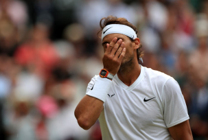 Rafael Nadal during his match against Jo-Wilfred Songa on day six of the Wimbledon Championships at the All England Lawn Tennis and Croquet Club, Wimbledon. (Photo by Mike Egerton/PA Images via Getty Images)