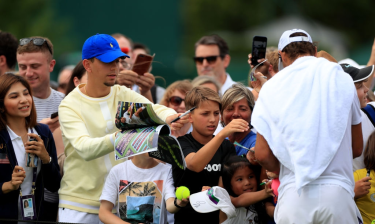 Rafael Nadal signs autographs for fans after a practice session on day nine of the Wimbledon Championships at the All England Lawn Tennis and Croquet Club, Wimbledon. (Photo by Mike Egerton/PA Images via Getty Images)
