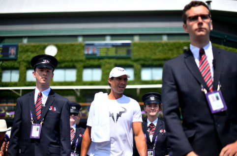 Rafael Nadal is escorted to a practice session on day ten of the Wimbledon Championships at the All England Lawn Tennis and Croquet Club, Wimbledon. (Photo by Victoria Jones/PA Images via Getty Images)