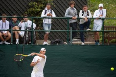 Junior players and their coaching teams watch Rafael Nadal (ESP) practise on the Competitors' Practice Courts. The Championships 2019. Held at The All England Lawn Tennis Club, Wimbledon. Middle Sunday, Sunday 07/07/2019. Credit: AELTC/David Gray