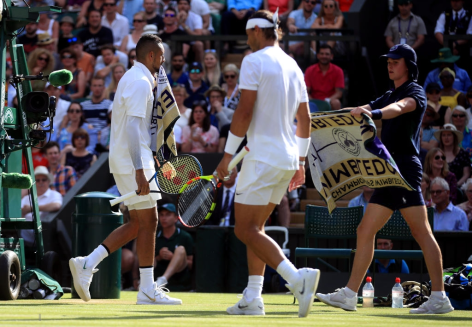 Nick Kyrgios (right) and Rafael Nadal are given their towels during their match on day four of the Wimbledon Championships at the All England Lawn Tennis and Croquet Club, Wimbledon. (Photo by Adam Davy/PA Images via Getty Images)