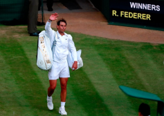 Spain's Rafael Nadal leaves the court after being beaten by Switzerland's Roger Federer during their men's singles semi-final match on day 11 of the 2019 Wimbledon Championships at The All England Lawn Tennis Club in Wimbledon, southwest London, on July 12, 2019. (Photo by ANDREW COULDRIDGE / POOL / AFP) / RESTRICTED TO EDITORIAL USE (Photo credit should read ANDREW COULDRIDGE/AFP/Getty Images)