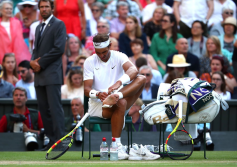 LONDON, ENGLAND - JULY 12: Rafael Nadal of Spain changes his socks during a change of serve in his Men's Singles semi-final match against Roger Federer of Switzerland during Day eleven of The Championships - Wimbledon 2019 at All England Lawn Tennis and Croquet Club on July 12, 2019 in London, England. (Photo by Clive Brunskill/Getty Images)