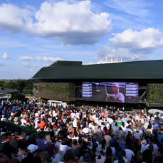 LONDON, ENGLAND - JULY 12: Spectators watch the Men's Singles semi-final match between Rafael Nadal of Spain and Roger Federer of Switzerland at Henman Hill during Day eleven of The Championships - Wimbledon 2019 at All England Lawn Tennis and Croquet Club on July 12, 2019 in London, England. (Photo by Laurence Griffiths/Getty Images)