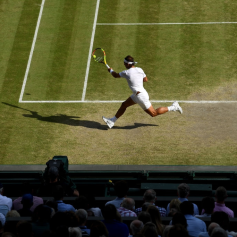 LONDON, ENGLAND - JULY 12: Rafael Nadal of Spain plays a forehand in his Men's Singles semi-final match against Roger Federer of Switzerland during Day eleven of The Championships - Wimbledon 2019 at All England Lawn Tennis and Croquet Club on July 12, 2019 in London, England. (Photo by Mike Hewitt/Getty Images)