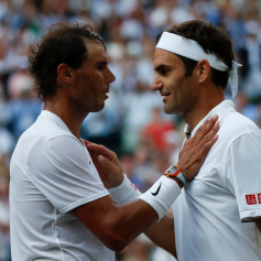 LONDON, ENGLAND - JULY 12: Roger Federer of Switzerland and Rafael Nadal of Spain embrace at the net after their Men's Singles semi-final match during Day eleven of The Championships - Wimbledon 2019 at All England Lawn Tennis and Croquet Club on July 12, 2019 in London, England. (Photo by Clive Brunskill/Getty Images)