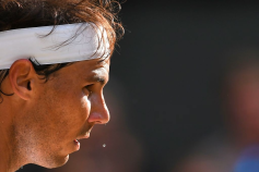 Spain's Rafael Nadal prepares to serve as sweat drips from his nose against Switzerland's Roger Federer during their men's singles semi-final match on day 11 of the 2019 Wimbledon Championships at The All England Lawn Tennis Club in Wimbledon, southwest London, on July 12, 2019. (Photo by Ben STANSALL / AFP) / RESTRICTED TO EDITORIAL USE (Photo credit should read BEN STANSALL/AFP/Getty Images)