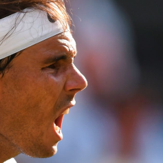 Spain's Rafael Nadal reacts after a point against Switzerland's Roger Federer during their men's singles semi-final match on day 11 of the 2019 Wimbledon Championships at The All England Lawn Tennis Club in Wimbledon, southwest London, on July 12, 2019. (Photo by Ben STANSALL / AFP) / RESTRICTED TO EDITORIAL USE (Photo credit should read BEN STANSALL/AFP/Getty Images)