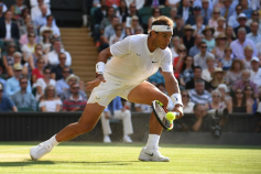 Spain's Rafael Nadal returns against Switzerland's Roger Federer during their men's singles semi-final match on day 11 of the 2019 Wimbledon Championships at The All England Lawn Tennis Club in Wimbledon, southwest London, on July 12, 2019. (Photo by Ben STANSALL / AFP) / RESTRICTED TO EDITORIAL USE (Photo credit should read BEN STANSALL/AFP/Getty Images)