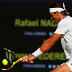 Spain's Rafael Nadal returns against Switzerland's Roger Federer during their men's singles semi-final match on day 11 of the 2019 Wimbledon Championships at The All England Lawn Tennis Club in Wimbledon, southwest London, on July 12, 2019. (Photo by Adrian DENNIS / AFP) / RESTRICTED TO EDITORIAL USE (Photo credit should read ADRIAN DENNIS/AFP/Getty Images)