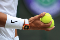 LONDON, ENGLAND - JULY 06: Rafael Nadal (ESP) wears an orange watch as he holds a handful of balls against Jo-Wilfried Tsonga (FRA) during their Gentlemen's Singles 3rd Round match on Day 6 of The Championships - Wimbledon 2019 at the All England Lawn Tennis and Croquet Club on July 6, 2019 in London, England. (Photo by Simon Stacpoole/Offside/Getty Images)