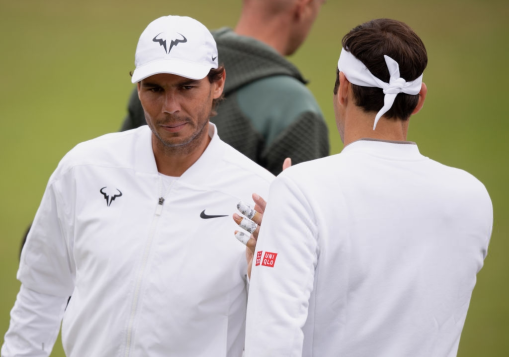 LONDON, ENGLAND - JULY 07: Rafael Nadal of Spain greets Roger Federer of Switzerland during a practice session during Middle Sunday of The Championships - Wimbledon 2019 at All England Lawn Tennis and Croquet Club on July 07, 2019 in London, England. (Photo by Matthias Hangst/Getty Images)