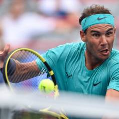 MONTREAL, QC - AUGUST 07: Rafael Nadal of Spain returns the ball as he rushes the net against Daniel Evans of Great Britain during day 6 of the Rogers Cup at IGA Stadium on August 7, 2019 in Montreal, Quebec, Canada. (Photo by Minas Panagiotakis/Getty Images)