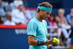 MONTREAL, QC - AUGUST 08: Rafael Nadal (ESP) selects the balls for serving during the ATP Coupe Rogers third round match on August 8, 2019 at IGA Stadium in Montréal, QC (Photo by David Kirouac/Icon Sportswire via Getty Images)
