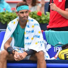 MONTREAL, QC - AUGUST 07: Rafael Nadal of Spain looks on as the rain disrupts play in his match against Daniel Evans of Great Britain during day 6 of the Rogers Cup at IGA Stadium on August 7, 2019 in Montreal, Quebec, Canada. (Photo by Minas Panagiotakis/Getty Images)