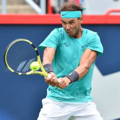 MONTREAL, QC - AUGUST 07: Rafael Nadal of Spain returns the ball against Daniel Evans of Great Britain during day 6 of the Rogers Cup at IGA Stadium on August 7, 2019 in Montreal, Quebec, Canada. (Photo by Minas Panagiotakis/Getty Images)