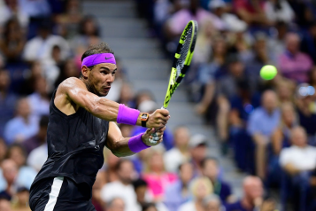 NEW YORK, NEW YORK - SEPTEMBER 02: Rafael Nadal of Spain returns a shot during his Men's Singles fourth round match against Marin Cilic of Croatia on day eight of the 2019 US Open at the USTA Billie Jean King National Tennis Center on September 02, 2019 in Queens borough of New York City. (Photo by Steven Ryan/Getty Images)