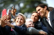 GENEVA, SWITZERLAND - SEPTEMBER 18: A fan takes a selfie with Rafael Nadal of Team Europe as he arrives at Palais Eynard for the official welcome ceremony prior to the Laver Cup 2019 at Palexpo, on September 18, 2019 in Geneva, Switzerland. (The Laver Cup consists of six players from the rest of the World competing against their counterparts from Europe. John McEnroe will captain the Rest of the World team and Europe will be captained by Bjorn Borg) The event runs from 20-22 Sept. (Photo by Julian Finney/Getty Images for Laver Cup)