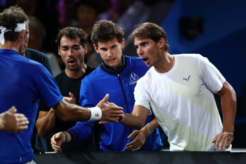 GENEVA, SWITZERLAND - SEPTEMBER 21: Roger Federer of Team Europe (L) celebrates with teammates Rafael Nadal, Dominic Thiem and Fabio Fognini after his singles match victory against Nick Kyrgios of Team World during Day Two of the Laver Cup 2019 at Palexpo on September 21, 2019 in Geneva, Switzerland. The Laver Cup will see six players from the rest of the World competing against their counterparts from Europe. Team World is captained by John McEnroe and Team Europe is captained by Bjorn Borg. The tournament runs from September 20-22. (Photo by Julian Finney/Getty Images for Laver Cup)