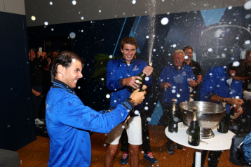 GENEVA, SWITZERLAND - SEPTEMBER 22: Rafael Nadal and Alexander Zverev of Team Europe celebrate in the locker room after winning the Laver Cup during Day Three of the Laver Cup 2019 at Palexpo on September 22, 2019 in Geneva, Switzerland. The Laver Cup will see six players from the rest of the World competing against their counterparts from Europe. Team World is captained by John McEnroe and Team Europe is captained by Bjorn Borg. The tournament runs from September 20-22. (Photo by Clive Brunskill/Getty Images for Laver Cup )